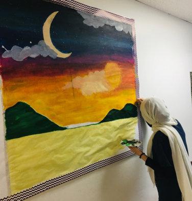 female muslim doing paint