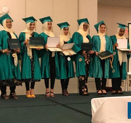 female muslims in graduation ceremony