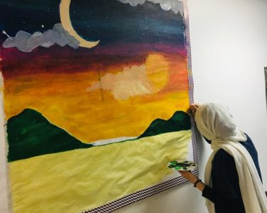 female muslim doing painting