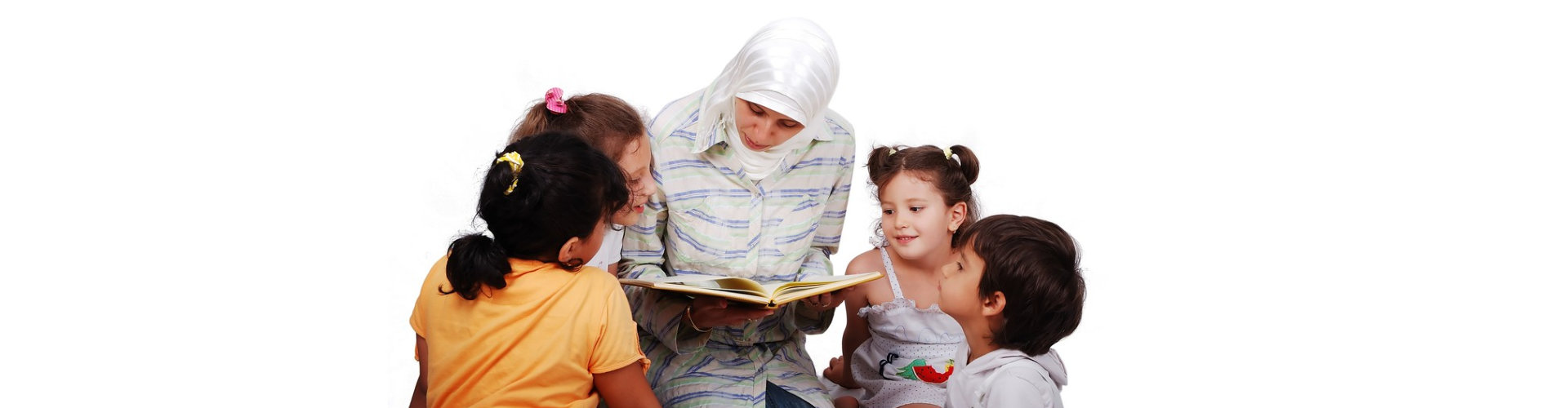 the teacher is reading while the children are listening